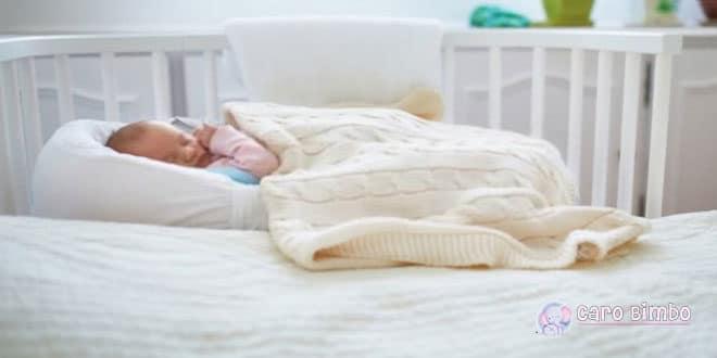 Come passare dal co-sleeping a una culla o letto?